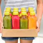 Juicing cold pressed vegetable juices for a detox diet. Dieting