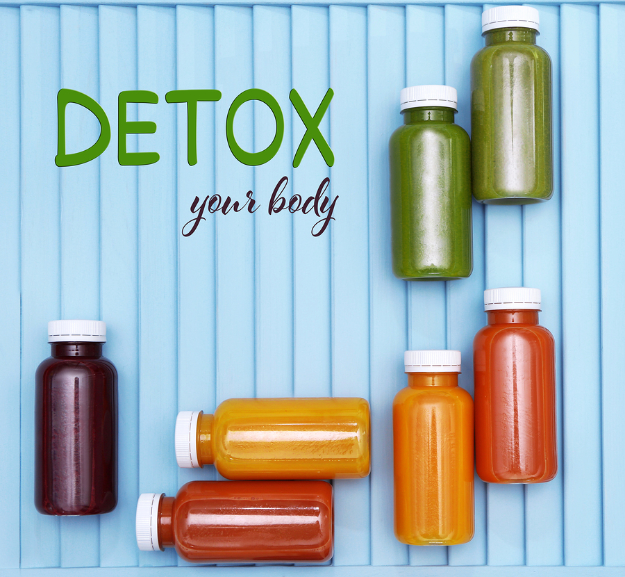 Bottles with delicious detox drinks and text detox your body on